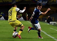 BOGOTA - COLOMBIA - 22 – 03 - 2018: Cristian Huerfano (Der.) jugador de Millonarios disputa el balón con Diego Barreto (Izq.) jugador de Alianza Petrolera, durante partido aplazado de la fecha 8 entre Millonarios y por la Liga Aguila I 2018, jugado en el estadio Nemesio Camacho El Campin de la ciudad de Bogota. / Cristian Huerfano (R) player of Millonarios vies for the ball with Diego Barreto (L) player of Alianza Petrolera, during a posponed match of the 8th date between Millonarios and Alianza Petrolera, for the Liga Aguila I 2018 played at the Nemesio Camacho El Campin Stadium in Bogota city, Photo: VizzorImage / Luis Ramirez / Staff.