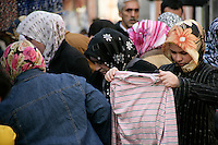 Turkish women shopping at a market in the Fener neighbourhood, Istanbul, Turkey