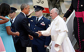 United States President Barack Obama greets His Holiness Pope Francis on his arrival at Joint Base Andrews in Maryland on September 22, 2015. The Pope is making his first trip to the United States on a three-city, five-day tour that will include Washington, D.C., New York City and Philadelphia. <br /> Credit: Olivier Douliery / Pool via CNP