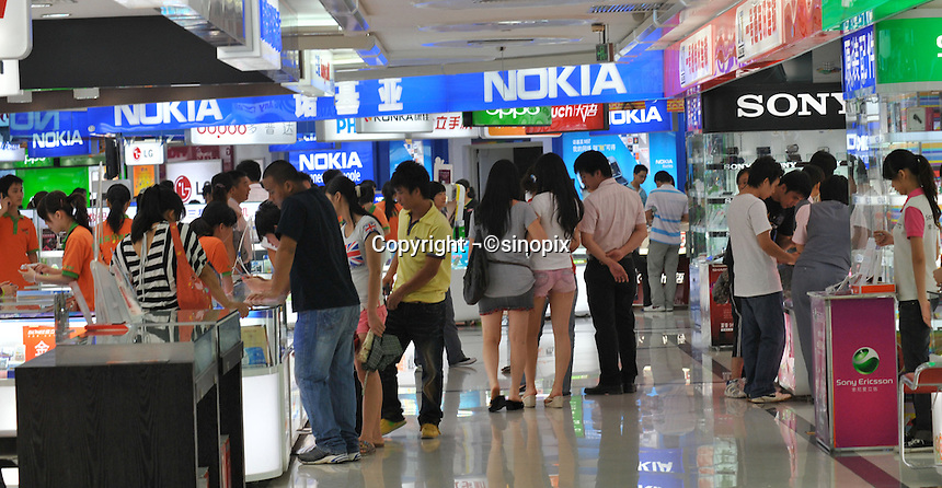 Various mobile phone shops in Guangzhou, China. The financial crisis won't have too much impact on Chinese consuming market. According to a survey by Nielsen of 50 countries and regions, only 35 percent of Chinese people believed the domestic economy was in a contraction. The figure was the lowest among the 50 world markets..