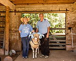 July 31, 2017. Chapel Hill, North Carolina.<br /> <br /> (left to right) Ginger Holler, Rameses the Ram and Don Basnight in the barn where Rameses lives. <br /> <br /> Basnight is one of the members of the Hogan family who have long been the caretakers of Rameses the Ram. The current Rameses is the 21st in the line of the University of North Carolina's live mascot.