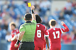 09 December 2012: Referee Hilario Chico Grajeda (in green) shows the yellow card to Indiana's Jacob Bushue (17). The Georgetown University Hoyas played the Indiana University Hoosiers at Regions Park Stadium in Hoover, Alabama in the 2012 NCAA Division I Men's Soccer College Cup Final. Indiana won the game 1-0.