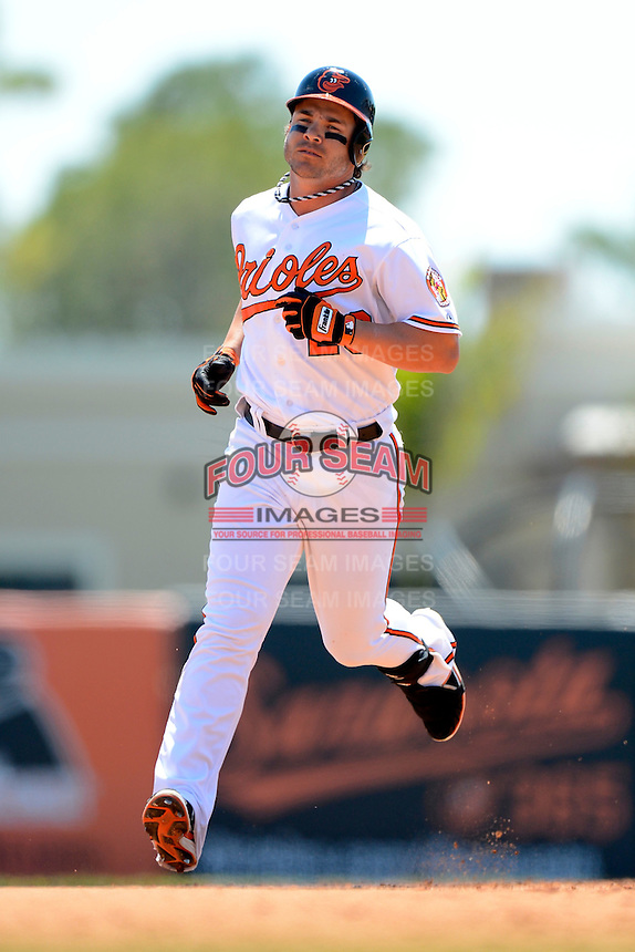Baltimore Orioles designated hitter Steven Pearce #28 runs the bases after hitting a home run during a Spring Training game against the New York Mets at Ed Smith Stadium on March 30, 2013 in Sarasota, Florida.  (Mike Janes/Four Seam Images)