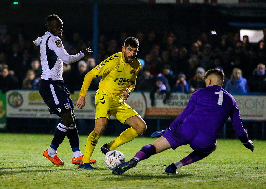 Guiseley's Joe Green saves from Fleetwood Town's Ched Evans<br /> <br /> Photographer Alex Dodd/CameraSport<br /> <br /> The Emirates FA Cup Second Round - Guiseley v Fleetwood Town - Monday 3rd December 2018 - Nethermoor Park - Guiseley<br />  <br /> World Copyright © 2018 CameraSport. All rights reserved. 43 Linden Ave. Countesthorpe. Leicester. England. LE8 5PG - Tel: +44 (0) 116 277 4147 - admin@camerasport.com - www.camerasport.com