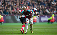 Marko Arnautovic of West Ham United & Ryan Bertrand of Southampton during the EPL - Premier League match between West Ham United and Southampton at the Olympic Park, London, England on 31 March 2018. Photo by Andy Rowland.