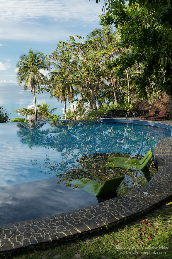 Anda, Bohol, Philippines; early morning reflections in the infinity pool at Amun Ini Resort