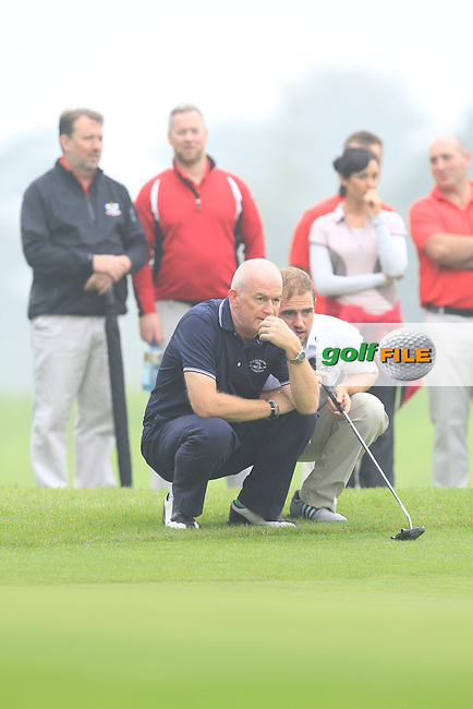 Declan Reidy (Co. Sligo) on the 17th green during the AIG Senior Cup Semi-Final between Co. Sligo &amp; Banbridge in the AIG Cups &amp; Shields at Carton House on Friday 19th September 2014.<br /> Picture:  Thos Caffrey / www.golffile.ie