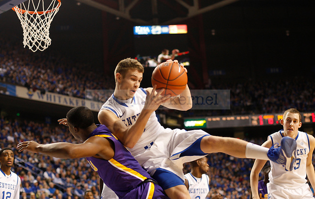 UK guard Jarrod Polson grabs the rebound while falling on LSU guard Anthony Hickey during the first half of the men's basketball game vs. LSU at Rupp Arena, in Lexington, Ky., on Saturday, January 26, 2013. Photo by Genevieve Adams  | Staff.