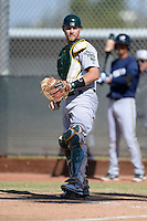 Oakland Athletics catcher Kyle Wheeler (22) during an Instructional League game against the Milwaukee Brewers on October 10, 2013 at Maryvale Baseball Park Training Complex in Phoenix, Arizona.  (Mike Janes/Four Seam Images)