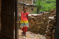 Monika Baniya (7) walks up the hill to the collapsed family home where her mother was killed during the earthquake in Chautara, Sindhupalchowk, Nepal on 29 June 2015. Her sister Aastha (6) was buried under the rubble together with her mother but Aastha survived while her mother died on the spot. As their father Ratna Baniya (28) cannot care for the children on his own, SOS Childrens Villages has since been supporting the grandmother with financial and social support so that she can manage to raise the children comfortably and ensure that they will all be schooled. Photo by Suzanne Lee for SOS Children's Villages