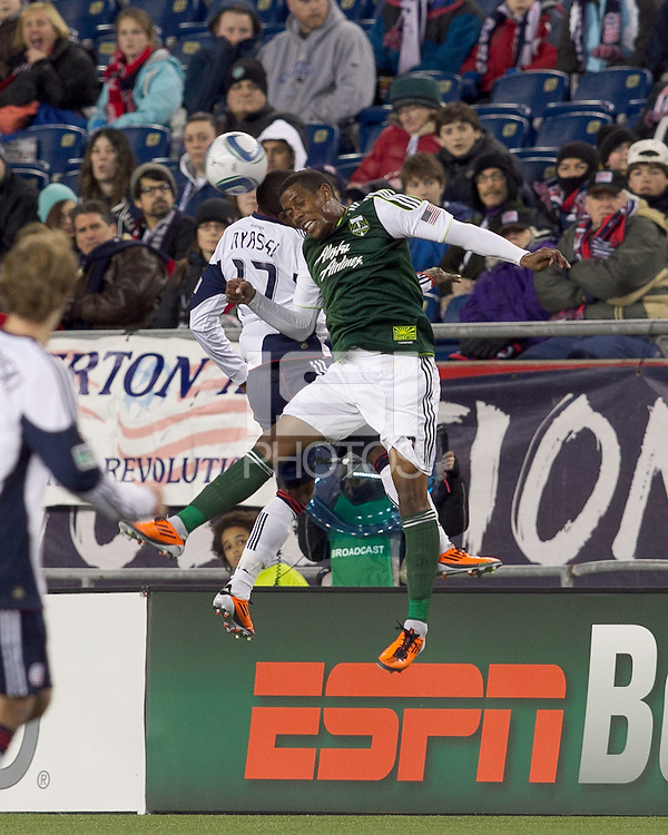 New England Revolution forward Sainey Nyassi (17) and Portland Timbers midfielder Jeremy Hall (17) battle for head ball. In a Major League Soccer (MLS) match, the New England Revolution tied the Portland Timbers, 1-1, at Gillette Stadium on April 2, 2011.