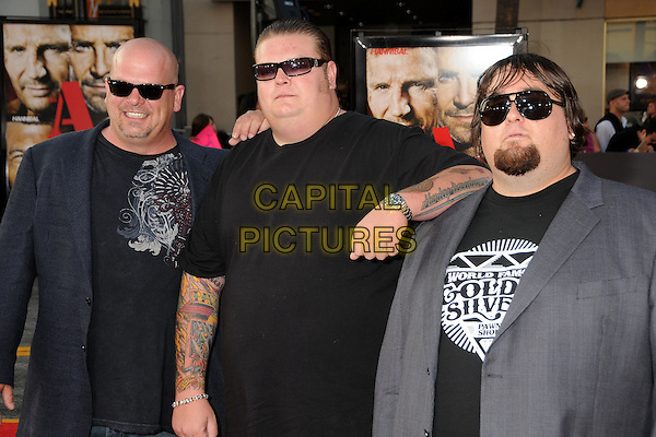 "CAST OF ""PAWN STARS"" - Rick Harrison, Corey Harrison & Austin ""Chumlee"" Russell.""The A-Team"" Los Angeles Premiere held at Grauman's Chinese Theatre, Hollywood, California, USA..June 3rd, 2010.half length blue grey gray black suit jacket top sunglasses shades goatee facial hair  tattoos.CAP/ADM/BP.©Byron Purvis/AdMedia/Capital Pictures."