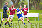Spa Andrew Garnett is stopped by Dromid's Tomas O Currain during their Intermediate semi final in Killorglin on Saturday