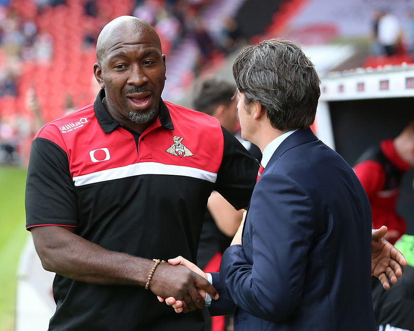 Fleetwood Town manager Joey Barton embraces Doncaster Rovers manager Darren Moore before kick off<br /> <br /> Photographer David Shipman/CameraSport<br /> <br /> The EFL Sky Bet League One - Doncaster Rovers v Fleetwood Town - Saturday 17th August 2019  - Keepmoat Stadium - Doncaster<br /> <br /> World Copyright © 2019 CameraSport. All rights reserved. 43 Linden Ave. Countesthorpe. Leicester. England. LE8 5PG - Tel: +44 (0) 116 277 4147 - admin@camerasport.com - www.camerasport.com