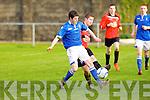 Tralee Dynamos Scott Monaghan and Limerick FC's Aidan Boyle.
