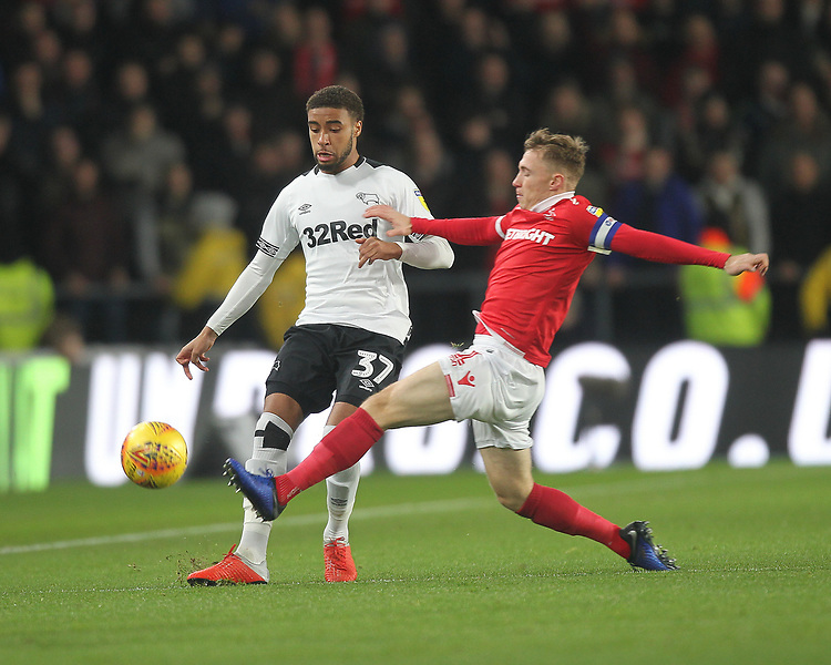 Derby County's Jayden Bogle in action with Nottingham Forest's Ben Osborn<br /> <br /> Photographer Mick Walker/CameraSport<br /> <br /> The EFL Sky Bet Championship - Derby County v Nottingham Forest - Monday 17th December 2018 - Pride Park - Derby<br /> <br /> World Copyright © 2018 CameraSport. All rights reserved. 43 Linden Ave. Countesthorpe. Leicester. England. LE8 5PG - Tel: +44 (0) 116 277 4147 - admin@camerasport.com - www.camerasport.com