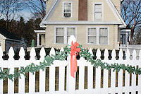 Christmas decorations hang on a white picket fence in Nashua, New Hampshire. Volunteers for Kentucky senator and Republican presidential candidate Rand Paul were canvassing the neighborhood.