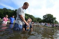 NWA MEDIA SAMANTHA BAKER @NWASAMANTHA<br /> Will Fusselman, right, looks up at his father, Scott Fusselman, as he is asked if he believes Christ is his savior Sunday, July 27, 2014, at Lake Avalon during Bella Vista Christian Church's baptizing event.