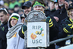 Nov 21, 2015; Eugene, OR, USA; A fan holds a headstone with their name on it at Autzen Stadium. <br /> Photo by Jaime Valdez