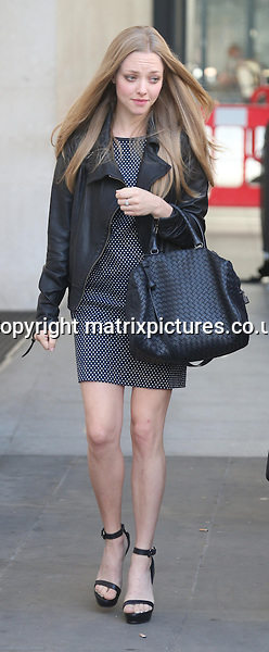 NON EXCLUSIVE PICTURE: MATRIXPICTURES.CO.UK<br /> PLEASE CREDIT ALL USES<br /> <br /> WORLD RIGHTS<br /> <br /> American actress Amanda Seyfried is pictured outside the BBC's Radio 1 Studio's in Central London.<br /> <br /> AUGUST 14th 2013<br /> <br /> REF: BNG 136189