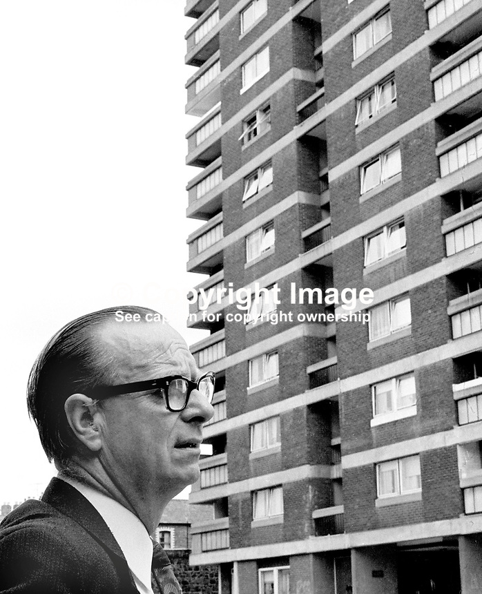 Gerry Fitt, an SDLP candidate in the N Ireland Assembly Election, contemplates climbing a lot of stairs and knocking a lot of doors at one of the multi-storey apartment blocks in his constituency.  He went on to win an assembly seat and became deputy chief executive of the short-lived Power-Sharing Executive created by the Sunningdale Agreement. 197306230444a<br />