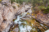 Boulder River at Natural Bridges State Park in Montana.   This is where the river drops into a hole in the mountain, disappears for a bit, then comes out as a waterfall on the other side of the small ridge.