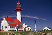 lighthouse, Gaspe Peninsula, Quebec, Metis-sur-Mer, Canada, Gulf of St. Lawrence, Pointe-de-Mitis Lighthouse with red roof in Metis-Sur-Mer along the St. Lawrence River on the Gaspe Peninsula in Quebec.