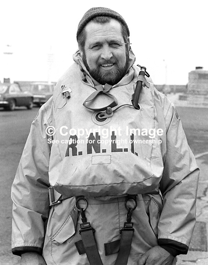 William Lennon, crewman, RNLI, Royal National Lifeboat Institution,  lifeboat, Donaghadee, Co Down, N Ireland, UK, 197303280156.<br /> <br /> Copyright Image from Victor Patterson, 54 Dorchester Park, Belfast, UK, BT9 6RJ<br /> <br /> t1: +44 28 9066 1296 (from Rep of Ireland 048 9066 1296)<br /> t2: +44 28 9002 2446 (from Rep of Ireland 048 9002 2446)<br /> m: +44 7802 353836<br /> <br /> e1: victorpatterson@me.com<br /> e2: victorpatterson@gmail.com<br /> <br /> The use of my copyright images is subject to my Terms &amp; Conditions.<br /> <br /> It is IMPORTANT that you familiarise yourself with them. They are available on my website at www.victorpatterson.com.<br /> <br /> None of my copyright images may be used on a website unless they are visibly watermarked, i.e. &copy; Victor Patterson within the body of the visible image. Metadata denoting my copyright must NOT be deleted. <br /> <br /> Web use (maximum size - 300 kb) is extra at currently recommended NUJ rates.
