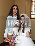 Sophie Everitt from St Brigids school who recieved first holy communion in Our Lady of Lourdes church with her sister Hannah. Photo:Colin Bell/pressphotos.ie