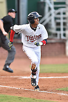 Elizabethton Twins second baseman Nelson Molina (12) runs to first during a game against the Johnson City Cardinals on July 30, 2015 in Elizabethton, Tennessee. The Twins defeated the Cardinals 13-4. (Tony Farlow/Four Seam Images)