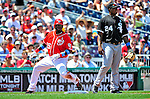 20 June 2010: Washington Nationals' infielder Cristian Guzman slides safely into third after hitting a triple against the Chicago White Sox at Nationals Park in Washington, DC. The Nationals were swept by the White Sox falling 6-3 in the last game of their 3-game interleague series. Mandatory Credit: Ed Wolfstein Photo
