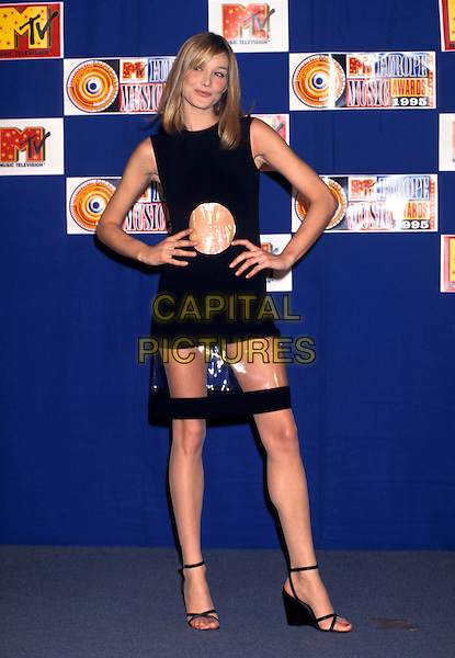 CARLA BRUNI.MTV Music Awards, Paris, France..November 23rd, 1995.full length black dress skirt plastic see through thru hands on hips .CAP/PL.©Phil Loftus/Capital Pictures.