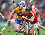 David Fitzgerald of Clare in action against Christopher Joyce of Cork during their Munster Senior game at Pairc Ui Chaoimh. Photograph by John Kelly.