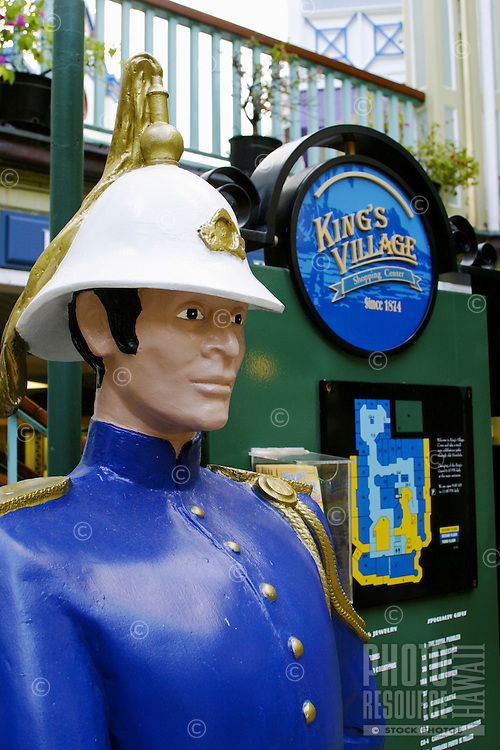 A statue of a Royal Guard invites tourist to view the Royal Gaurds' daily evening performance event at the King's Village near Waikiki Beach, Oahu.