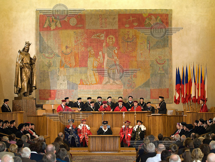 Award ceremony for the giving of an Honorary Doctorate in Science at Charles University offered by the Academy of the Sciences and the Academic Senate. Jan Hus received his Bachelor of Arts degree in 1393 and his Masters in 1396 from this university. In 1400 he was ordained as a pries and served as rector of the university from 1402 until 1403. <br /> Jan Hus (or John Huss, 1369 - 1415) was a Czech priest, philosopher and one of the first church reformers. Hus attacked moral failings among the clergy and promoted some of the teachings of John Wycliffe (1331 - 1384), an English reformere who had been burned at the stake in 1384. Hus was excommunicated for his views in 1410 and burned at the stake as a heretic in Konstanz on 6 July 1415.