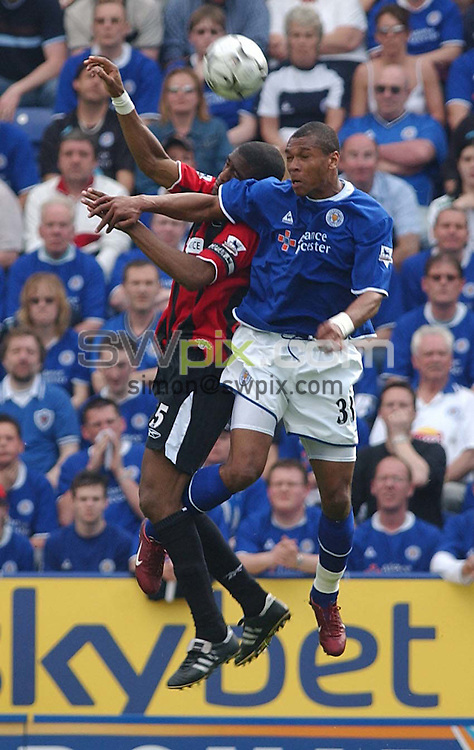 Pix: Daniel Hambury/SWpix.com. Football,.FA Barclaycard Premiership..LEICESTER CITY  V MANCHESTER CITY   24/4/04..COPYRIGHT PICTURE>>SIMONWILKINSON>>0870 092 0092>>..Leicester City's Marcus Bent and Man City'sSylvain Distin..