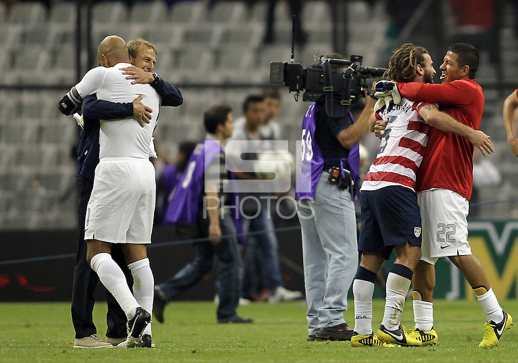 MEXICO CITY, MEXICO - AUGUST 15, 2012:  Coach Jurgen Klinsmann and goalie Tim Howard of the USA MNT celebrate their victory over Mexico with Nick Rimando and Kyle Beckerman during an international friendly match at Azteca Stadium, in Mexico City, Mexico on August 15. USA won 1-0.