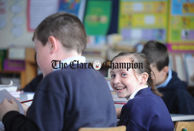 Gráinne Howley is all smiles in class at Kilfemora National School. Photograph by Declan Monaghan