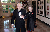 CBS News anchor Bob Schieffer, left, and Patricia Schieffer arrive for the State dinner in honor of Japanese Prime Minister Shinzo Abe and Akie Abe April 28, 2015 at the Booksellers area of the White House in Washington, DC. <br /> Credit: Olivier Douliery / Pool via CNP