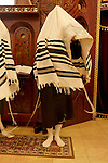 Israel, Bnei Brak. The Synagogue of the Premishlan congregation on Purim holiday, the Priests with their shoes off are covering their heads with the Taliths during the Priestly Blessing prayer, 2005<br />