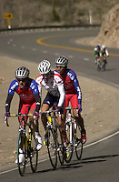 Cyclist Tom Danielson and a pair of Puerto Rican racers climb towards the summit of Molas Pass near Durango, Colorado in the 2002 Iron Horse Bicycle Classic road race event.