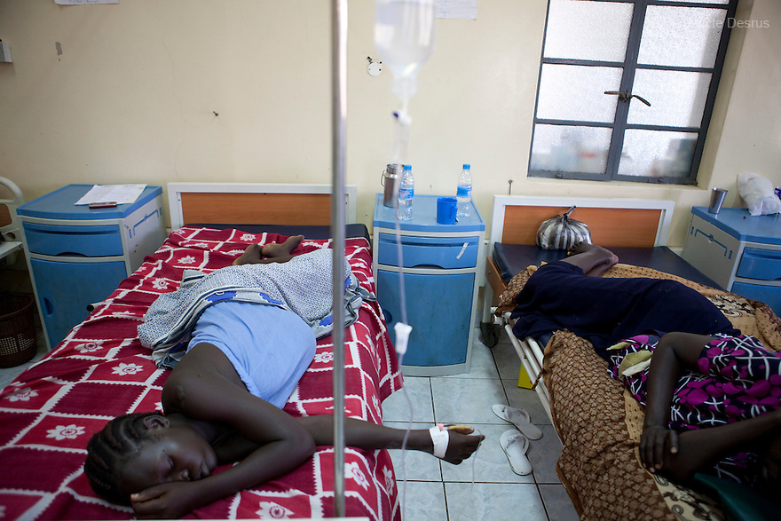 "July 6, 2011 - Juba, Republic of South Sudan - Agnes Gago (L), a South Sudanese pregnant woman, a few hours before giving birth to her second child at the Juba Teaching Hospital, South Sudan's oldest, and by far the largest and best-equipped in the new country. She said, ""I'm not scared but I came to the hospital because I needed help. I can't give birth at home because I'm unable to cut the cord and clean the baby myself. At home there are no facilities and no medications"". South Sudan has the highest maternal mortality rate in the world. One in seven South Sudanese women is likely to die because of complications from delivery. Just 10 per cent of South Sudanese women have access to medical professionals during childbirth. Photo credit: Benedicte Desrus"