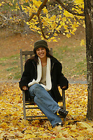 fall leaves happy girl posing in rocking chair