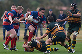 Amos Mataia tries to step out of Brendon Farrell's tackle . Counties Manukau Premier Club Rugby semi final game between Ardmore Marist & Pukekohe played at Bruce Pulman Park Papakura on Saturday July 19th 2008. Ardmore Marist won 18 - 15 & will meet Patumahoe in the final next weekend.