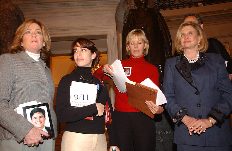 12/06/04.INTELLIGENCE REFORM BILL--Family members mary Fetchet, Carie Lemack, and Beverly Eckert with Carolyn B. Maloney, D-N.Y., with other family members wait in Statuary Hall to deliver a petition to House Speaker J. Dennis Hastert, R-Ill., urging him to schedule a vote on the intelligence reform bill before the imminent end of the 108th Congress. Eckert holds a copy of the petition..CONGRESSIONAL QUARTERLY PHOTO BY SCOTT J. FERRELL