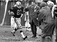 Raiders coach John Madden happy watching Warren Wells big gain...(1969 photo/Ron Riesterer)