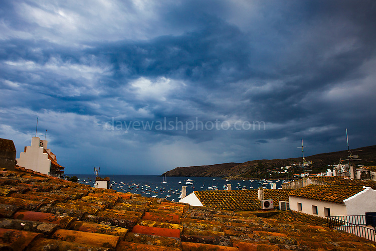 Dark clouds of a Summer Storm over the bay in Cadaques, Catalonia, Spain.