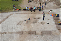 BNPS.co.uk (01202 558833) <br /> Pic: BournemouthUniversity/BNPS<br /> <br /> Bournemouth University students working at the Winterbourne Kingston Archaelogical dig. <br /> <br /> <br /> A group of first year university students have made one of the most significant archeological finds of recent times after discovering the 1,700-year-old remains of a wealthy Roman family.<br /> <br /> The budding archaeologists discovered a grave containing five super-rich Romans in a farmer's field in rural Dorset just metres from where a 4th century villa was found.<br /> <br /> Although more than 700 Roman villas have been found in Britain, it is the first time ever the people who lived in them have been uncovered.<br /> <br /> Experts have described the find as &quot;hugely significant&quot; - and say it could provide vital clues to who was living in Britain around 350 AD.<br /> <br /> Around 85 students, mostly aged in their late teens and early 20s, made the landmark discovery after carrying out a study on a corn field near Winterbourne Kingston near Blandford in Dorset.