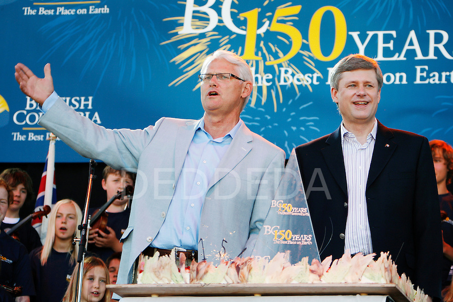 Prime Minister Stephen Harper and Premier Gordon Campbell sing happy birthday as they stand in front of a birthday cake for British Columbia's 150th Anniversary Celebration at the British Columbia Legislature in Victoria, BC. Photo assignment for Canadian Press (CP) news wire service.