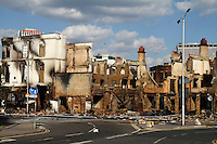 The completely burnt out and destroyed Reeves furniture store next to other burnt out buildings in the London borough of Croydon. London saw the beginnings of riots on Saturday evening, after a peaceful protest in response to the shooting by police of Mark Duggan during an attempted arrest, escalated into violence. By the third night of violence, rioting and looting had spread to many areas of the capital and to other cities around the country.